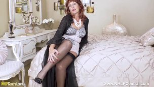 Mature hottie Beau Diamonds in lacy corselette and nylons toying her pussy