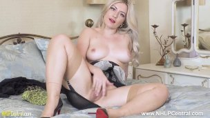 Busty blonde Elle Hunter frigs off in vintage corselette nylons and heels